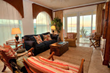 Open dining and living room areas are beautifully furnished.