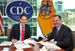 Dr. Tom Frieden, CDC Director, and Mr. Kenneth Myers, DTRA/SCC-WMD Director, Department of Defense, sign the Memorandum of Agreement between CDC and DTRA/SCC-WMD, Department of Defense. (Photo: CDC)