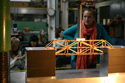 A student waits anxiously as her model bridge is put to the test at the 47th Annual Colorado High School Bridge Building Competition on Saturday, Feb. 22 in Denver.