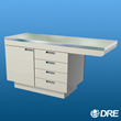 The DRE Millwork Cabinet Style Exam Table is made of strong 16-gauge stainless steel.