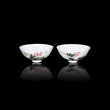 A pair of Qing Dynasty Famille-Rose Floral Bowls with Grasshoppers amidst blossoms on one and pea pods on the other. Each is inscribed with a poem. Lot 190. $1,000,000-$1,500,000