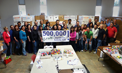 Cisco volunteers assemble RAFT's 500,000th learning kit