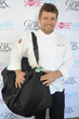 Ben Ford Poses with His Gift Bag at the GBK and Food Network South Beach Wine & Food Festival presented by FOOD & WINE