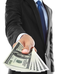 Image credit: <a href='http://www.123rf.com/photo_14314621_close-up-of-businessman-s-hand-offering-money-isolated-over-white-background.html'>ferli / 123RF Stock Photo</a>