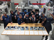 CNC Machinist NOW students celebrate machining perfect parts.