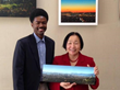 Fine Art Photographer Diallo Mwathi Jeffery presents photograph of Oakland skyline to Mayor Jean Quan