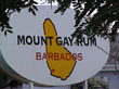 A photograph of the Mount Gay Distilleries Company Sign