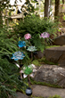 The lifelike blooms, crafted of glass, are supported by a metal garden stakes and release a white LED glow in the dark.