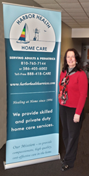 Louann Jobbitt, one of the owners of Harbor Health poses proudly at the offices of Harbor Health Home Care