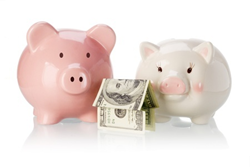 Image credit: <a href='http://www.123rf.com/photo_9593296_pair-of-piggy-banks-with-money-house-on-white-background.html'>design56 / 123RF Stock Photo</a>