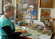 Artist jean Cullinane painting in her studio