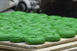 Fresh hand-rolled green bagels being made in New York