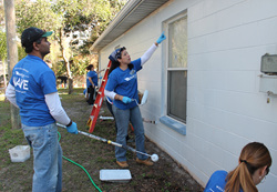 "WellCare employees, family and friends help revitalize the homes of two East Tampa women as part of Habitat for Humanity of Hillsborough County, Inc.'s ""A Brush with Kindness"" event on March 1."