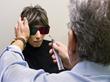 Dr. Lampert examines a patient