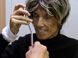 Patient at Regents Park Boca Raton tests her ability to place a stick within a straw.