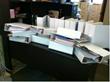 A supervisor's caseload requires eighteen 3-inch binders of data.