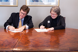 BVU President Fred Moore (left) and Gail Agrawal, Dean and F. Wendell Miller Professor of Law at University of Iowa College of Law (right) sign the agreement for BVU and Iowa Law's 3+3 Accelerated Entry to Law School Program.
