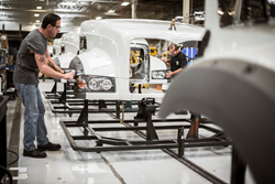 Workers assemble a truck at Mack Trucks' Macungie Cab and Vehicle Assembly plant.