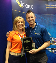 Nitel Channel Manager Jackie Steinberg presents Telarus Co-Founder Patrick Oborn with the Top Partner Plaque