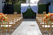 Gold Chaivari Chairs for Ceremony on Outdoor Patio