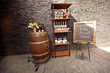 Rustic Vignette of Wine Barrel, Rustic Shelf and Chalkboard