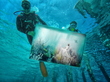 Scuba Divers Installing Andreas Franke Underwater Photography Exhibit at Per AQUUM Huvafen Fushi, Maldives