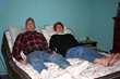 Easy Rest adjustable bed sweepstakes winner and husband pictured laying down in bed test the features of their new bed.