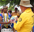 The Scientology Volunteer Ministers present a copy of the Scientology Handbook to the traditional healers of the Pedi Nation.