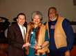 Reverend and Cleo McLaughlin receive award for their years of support.