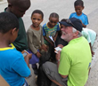 A volunteer shares The Way to Happiness with youngsters from Plettenberg Bay, South Africa.