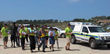 Volunteers and police set out February 16, 2014, to bring The Way to Happiness to households throughout Plettenberg Bay, South Africa.