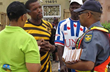 Plettenberg Bay police officers partner with local volunteers to help the community by distributing The Way to Happiness, a nonreligious moral code based entirely on common sense.