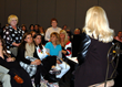 Psychic readings for the audience take place at seven seminars.