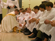 Fr. Ben Holdren washing feet of students