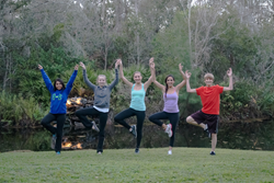Teenagers learning about the benefits of yoga at The Lotus Pond - Center For Yoga and Health