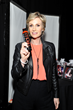 Jane Lynch, actress from the TV show, Glee holding Tibolli's Bubble Free Shampoo