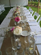 Play around with the table arrangement, long tables can be decorated with numerous small centerpieces.