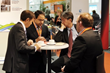 Zakiul Kabir of ClearEdge Power in South Windsor, Conn., talks with attendees at Hannover Messe.