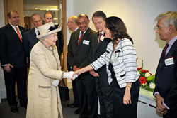Muna Issa greets HM The Queen while HRH The Duke of Edinburgh and HRH The Earl Of Wessex look on