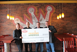 Toppers Executives Celebrate Contributions to Feeding America