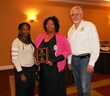 Zantae McCrae, Residential staff member of the year  Sonya White and board president James Montgomery.