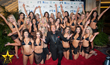 Host Jim Gibson With International Models On The Red Carpet