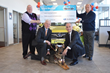 "L to R: :  David Orsini, District Marketing Consultant, Fixed Operations District 4, Subaru of New England; Peter Krause, President, Suburban Subaru; Fidelco Guide Dog ""Melo""; Eliot D. Russman, CEO &"