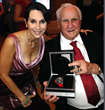 Robin Levinson of Levinson Jewelers with Coach Don Shula presenting GRAHAM donation watch