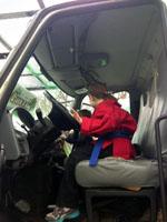 Kids tour Giroud's Bucket Truck at Glenside Library's Big Truck Day