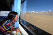 A Tibetan woman is on the train to Lhasa.