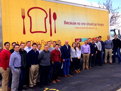 NuGrowth Solutions loading their donations into the Mid-Ohio Foodbank truck.