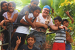 Tony with kids while building a house in the community of La Ceibita, Masaya in Nicaragua