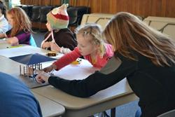 Martha Gaty shares playground model with Forest Grove children