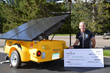 Antlers at Vail General Manager Rob LeVine next to the Town of Vail solar-powered VoltsWagon that the Antlers helped sponsor